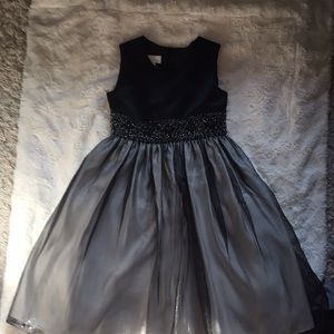 Black dress with sequins band at waist -